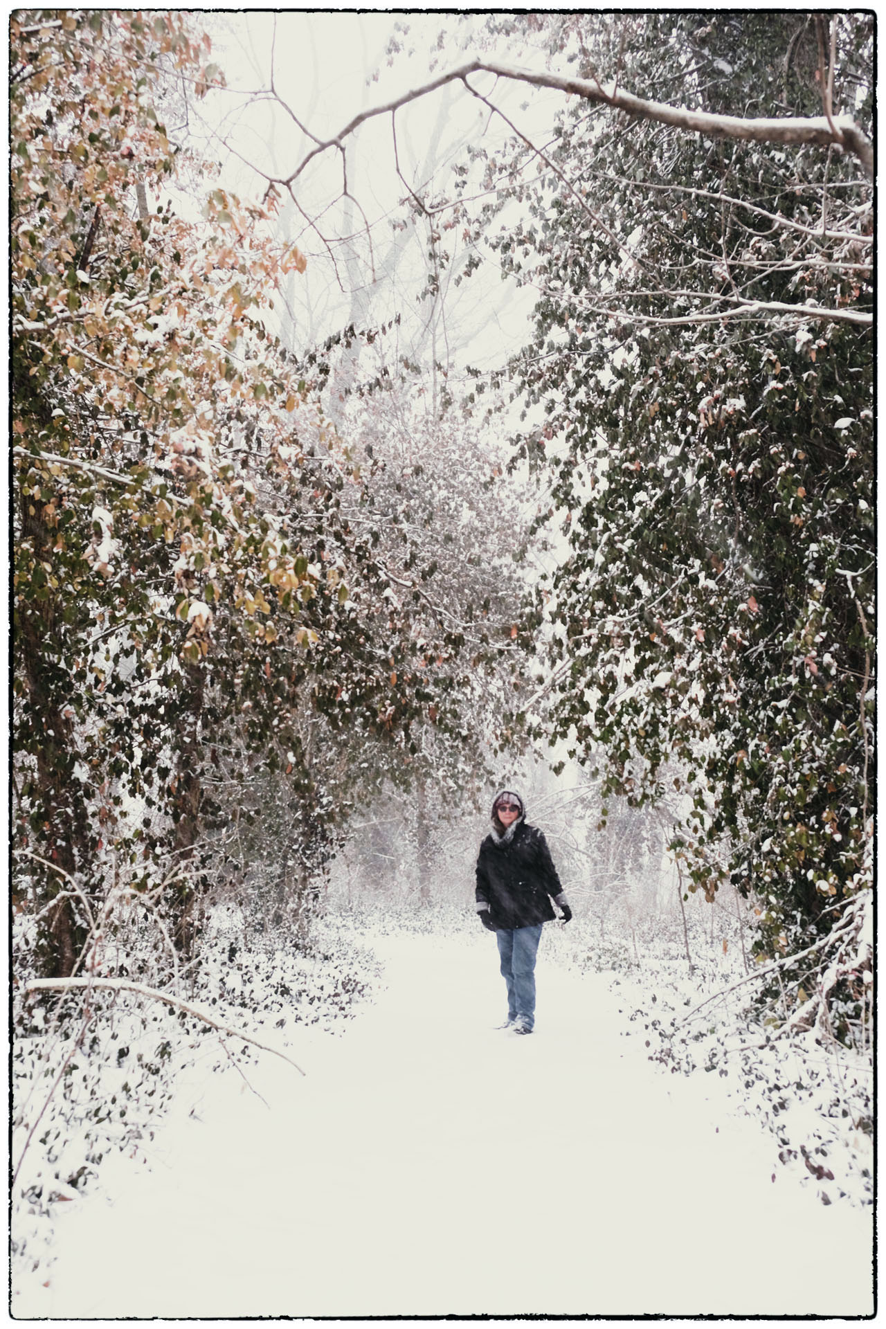 Cheryl Unruh standing in snowy forest path